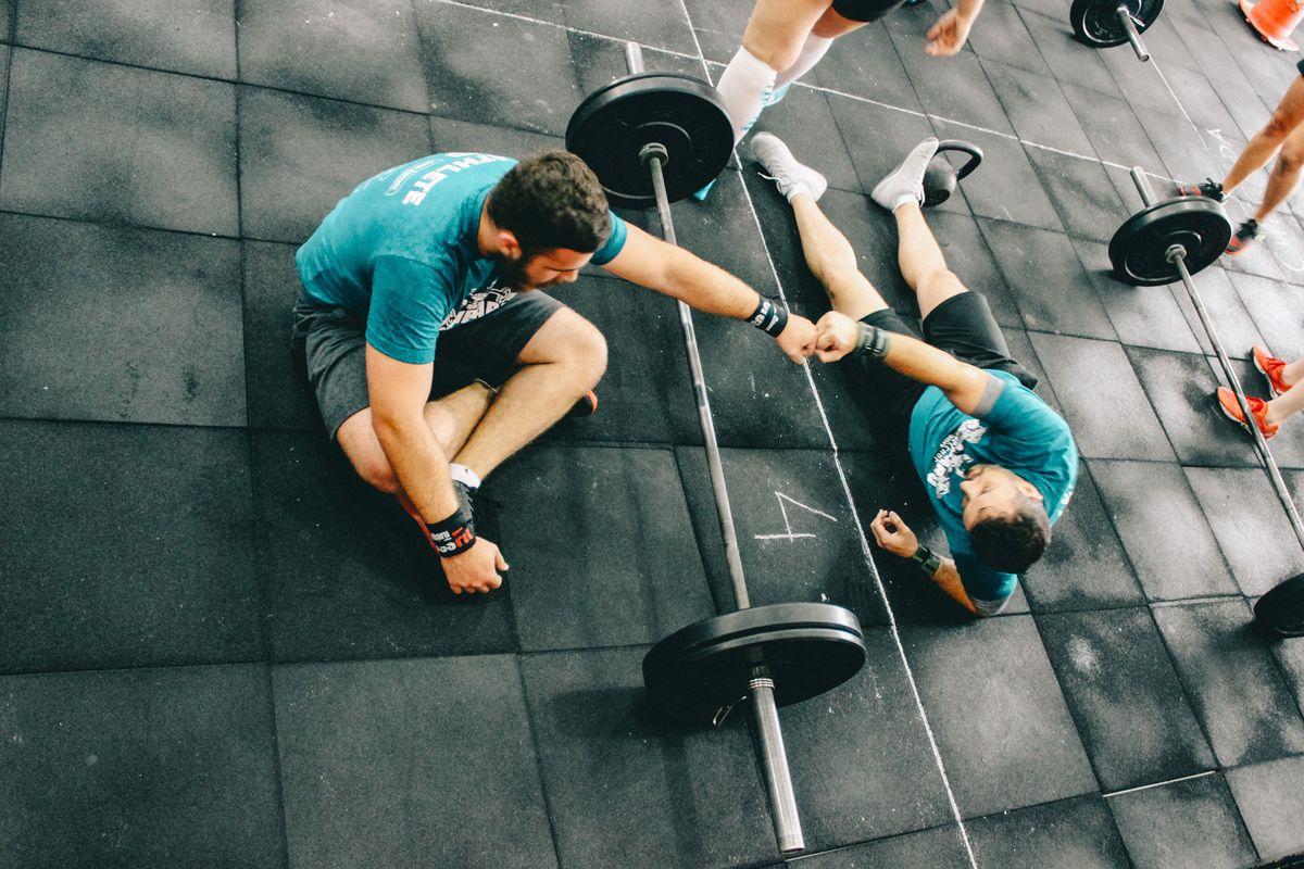 Personal trainer and client working out in a gym