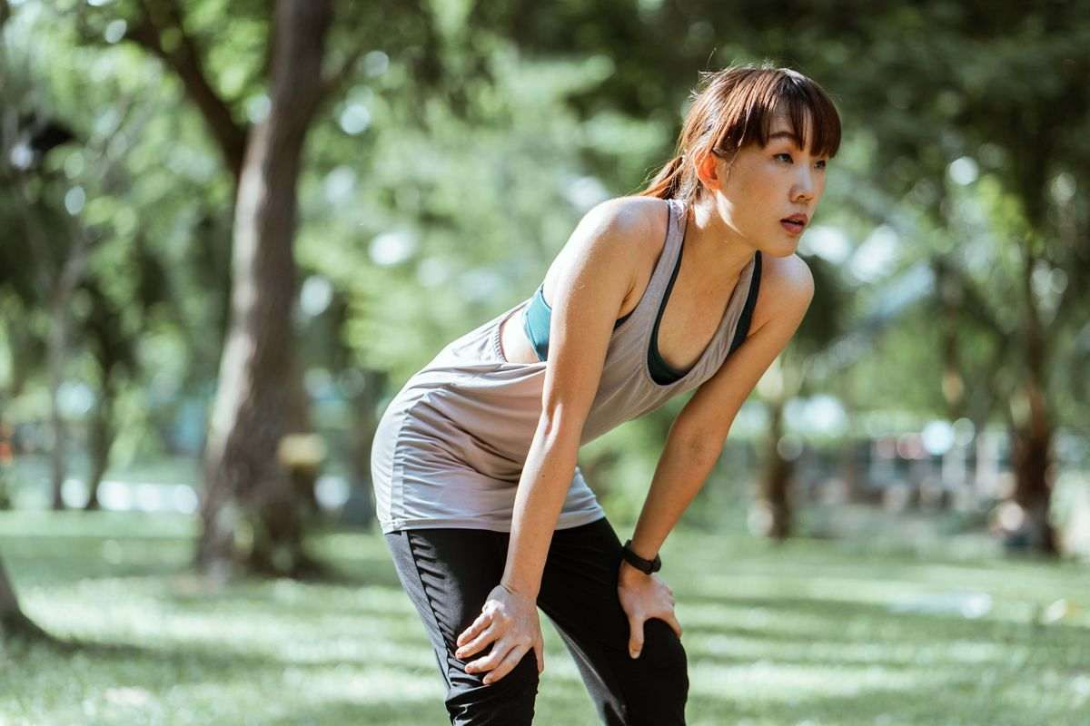 A woman stretching to promote post-exercise recovery.