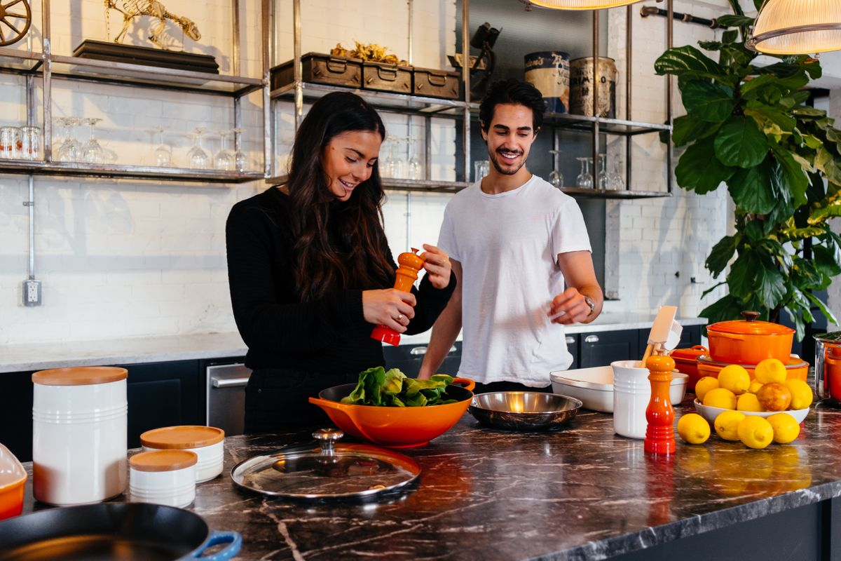 Fit couple preparing healthy food
