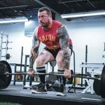 A man benefitting from strongman supplements.