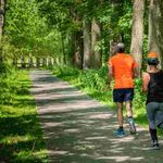 Personal trainers for seniors taking a run.