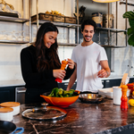 Fit couple preparing healthy food