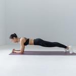 Woman following a bodyweight workout plan for beginners