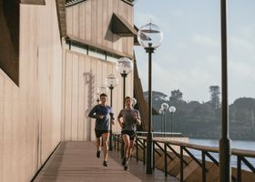 A weight loss personal trainer running with a client