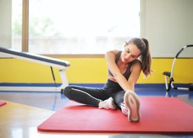 Pilates personal trainer stretching