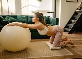 A woman doing post-pregnancy weight loss exercise.