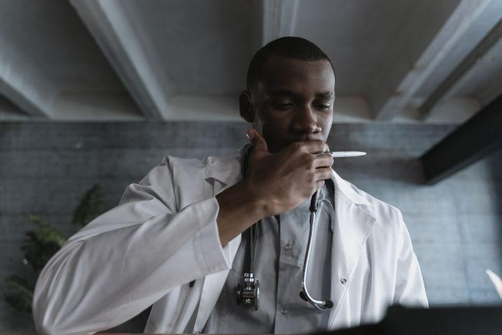A doctor looking at TRT results.