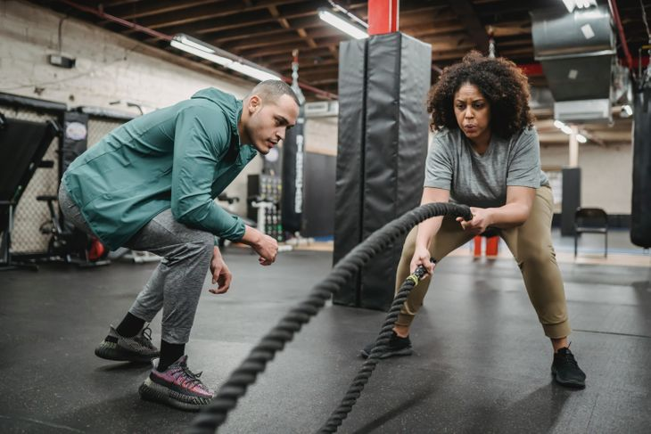 People working to get new personal training clients.