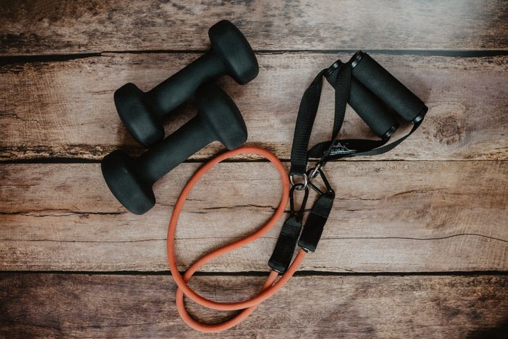 Resistance bands can be useful for total body HIIT workouts.