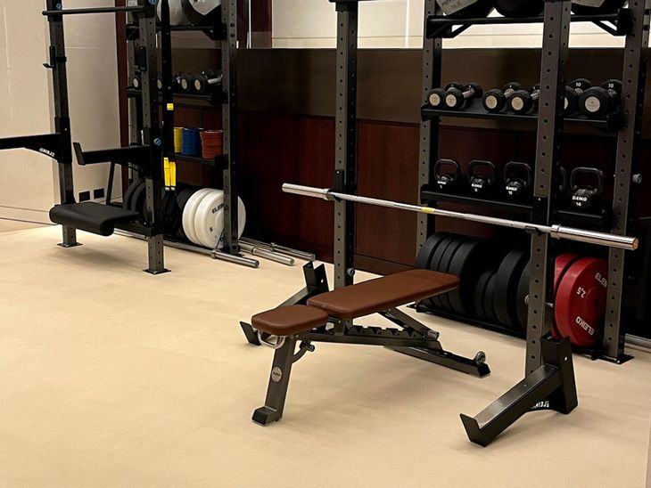 Bench on gym flooring for a home gym.