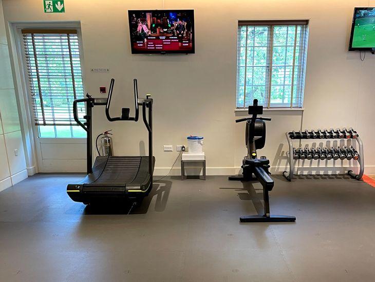 Treadmill on gym flooring for a home gym.