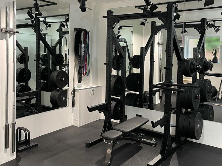 Weights on gym flooring for a home gym.