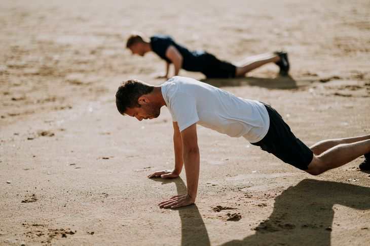Man doing burpees as part of a weight loss circuit workout.