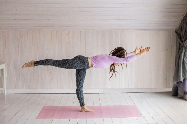 Woman doing bodyweight deadlifts as part of a weight loss circuit workout.