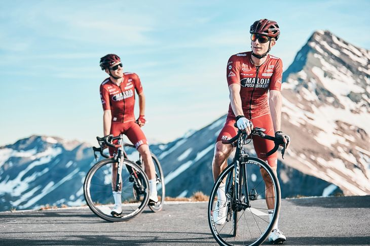 Two cycling personal trainers in the mountains.
