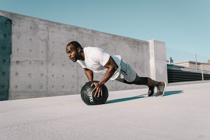Man doing push ups as part of a weight loss circuit workout.