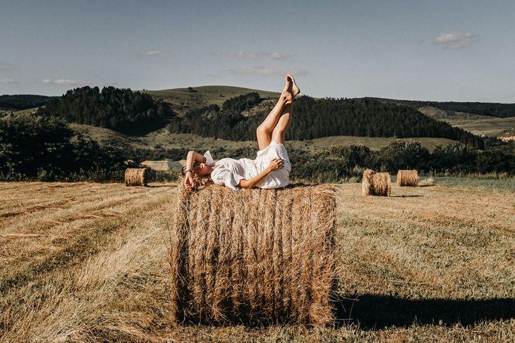 Woman doing leg raises as part of a weight loss circuit workout.