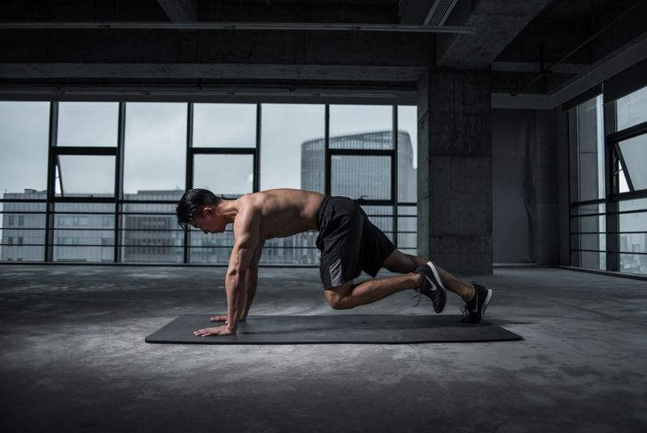 Man doing mountain climbers as part of a weight loss circuit workout.