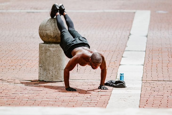 Man doing incline push ups as part of a weight loss circuit workout.