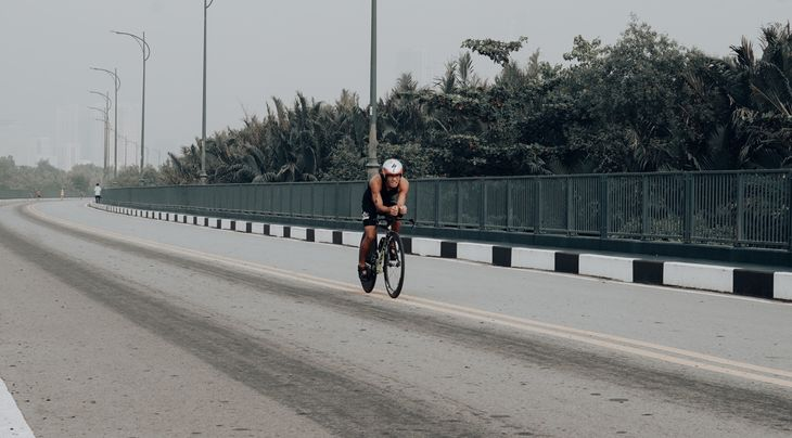 Fit cyclist racing on the road