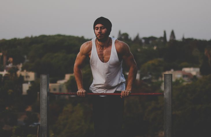 A man doing a superhero workout.