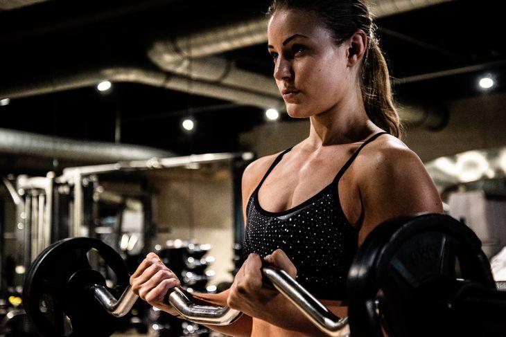 A woman doing a superhero workout.